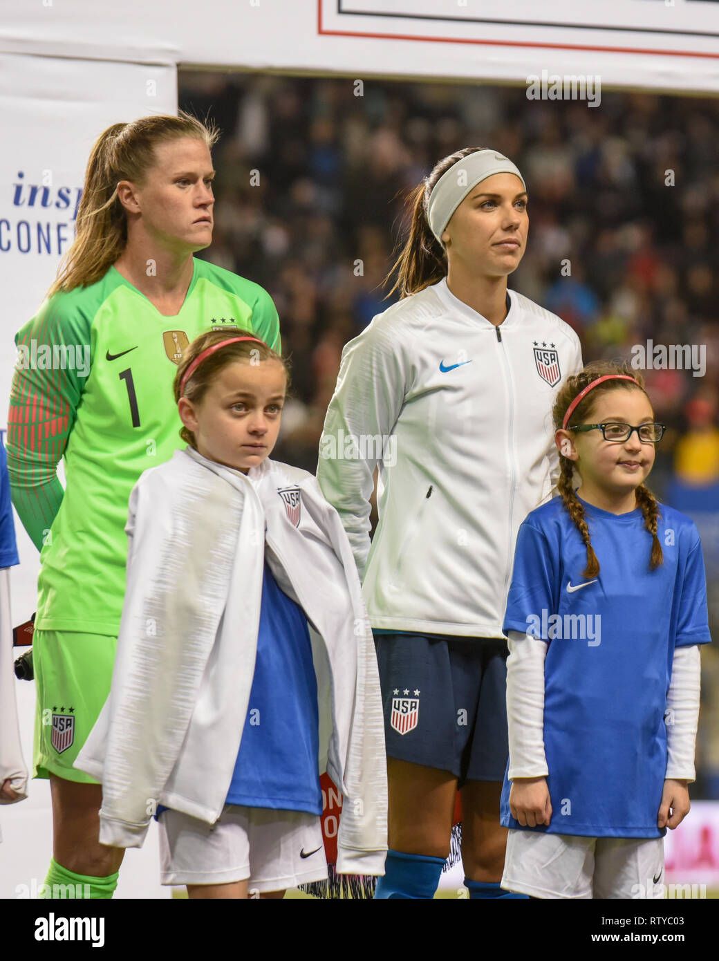 Alyssa Naeher US goalkeeper gives her warmup jacket to a young girl during pregame events at the SheBelieves cup in Chester PA - Alex Morgan pictured - Stock Image
