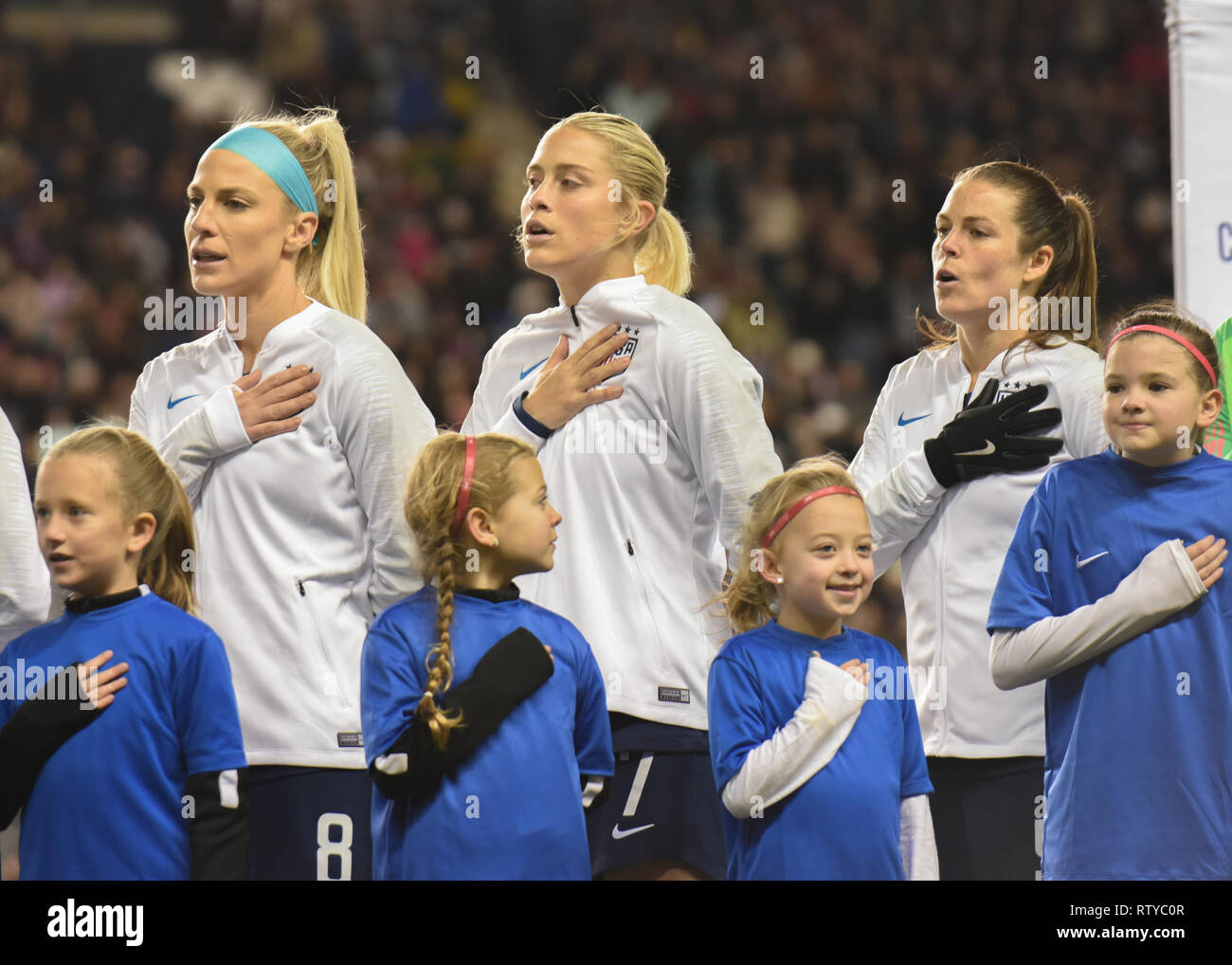 Julie Ertz / Julie Johnston sings the national anthem before a 2019 international World Cup friendly. - Stock Image