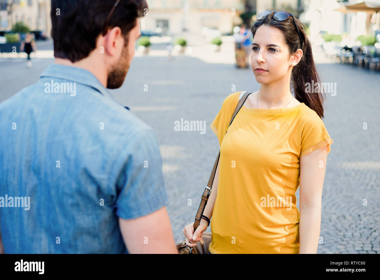 Young couple arguing in the city street - Stock Image