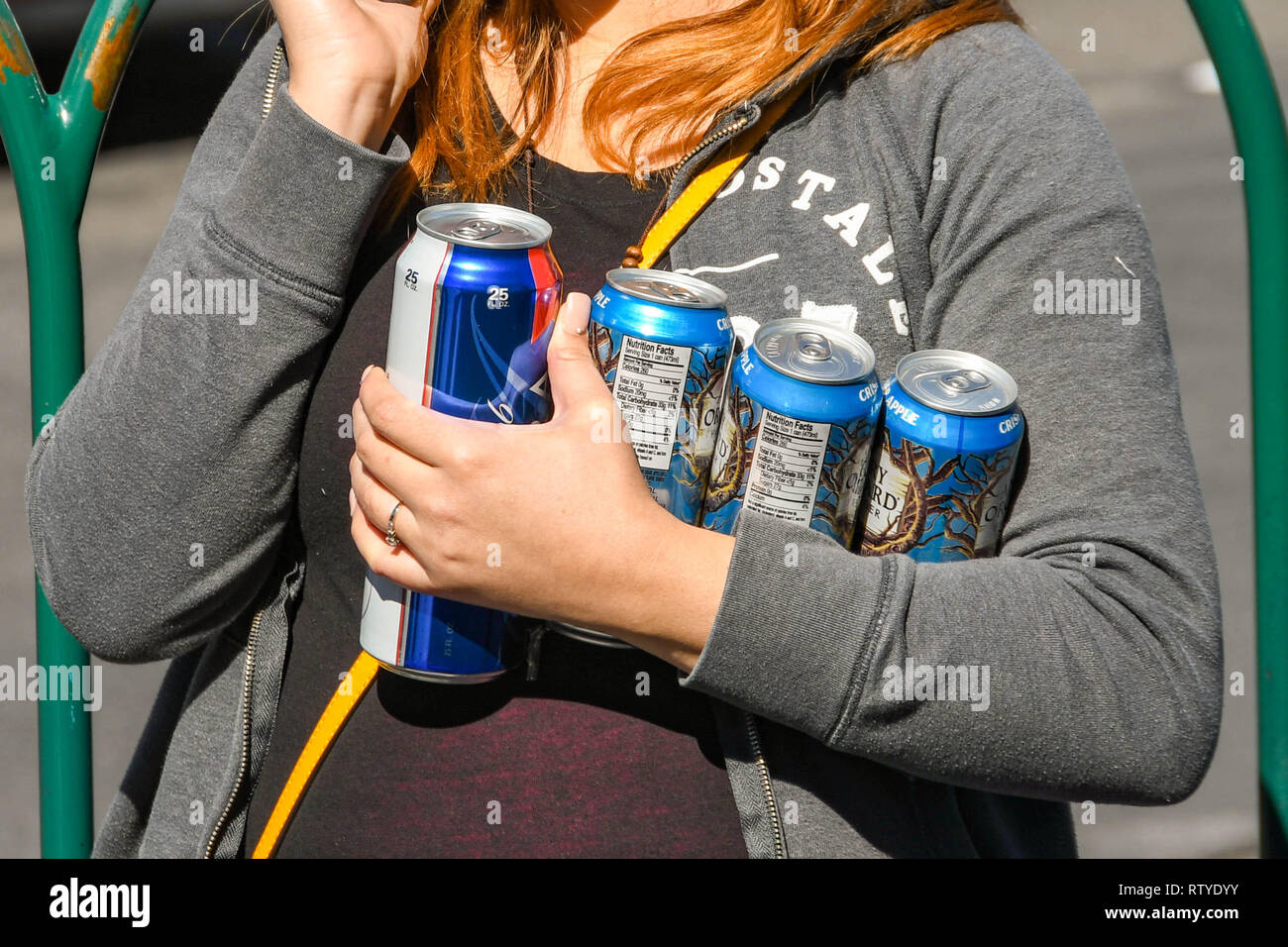 LAS VEGAS, NEVADA, USA - FEBRUARY 2019: Person holiding beer cans on Las Vegas Boulevard, which is also known as The Strip. - Stock Image