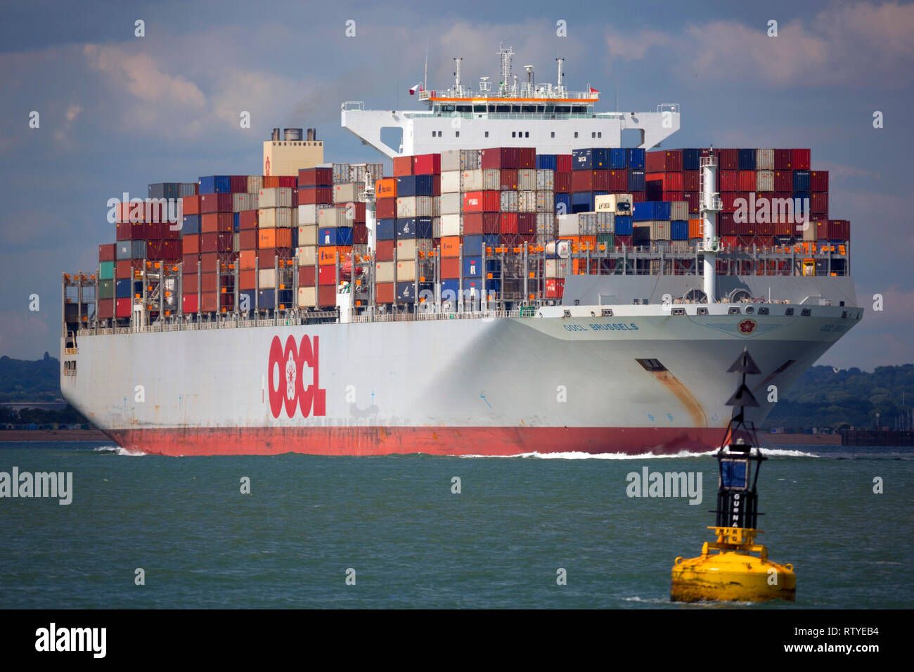 Brexit, lite,empty,Close up,OOCL, Container Ship, leaving, Southampton, Port, The Solent, Cowes, Isle of Wight, Stock Photo