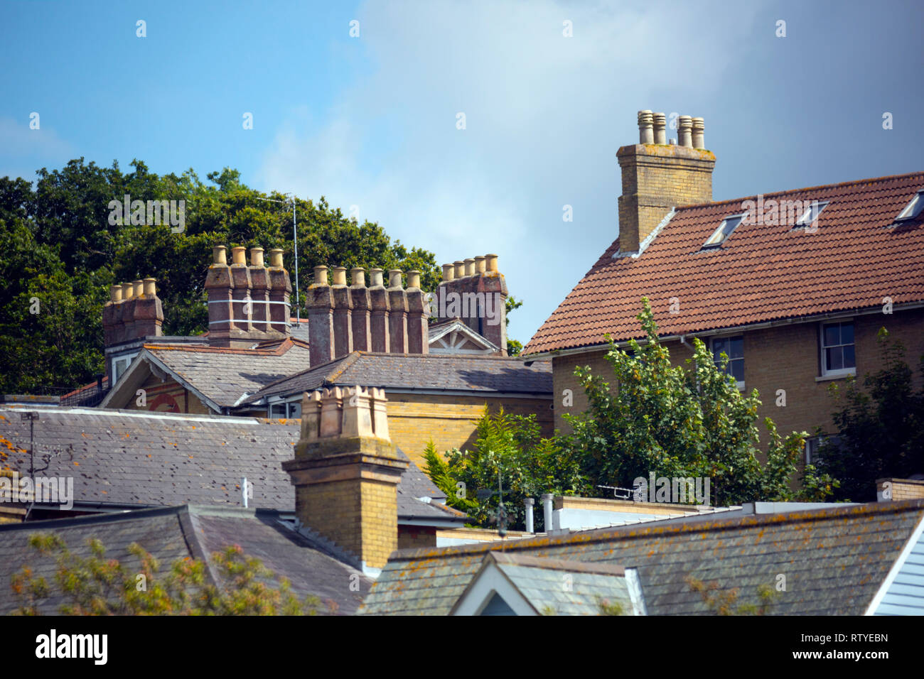 chimney,pots,roof,roofs, houses, ridge,tiles, gable,end,ends, - Stock Image