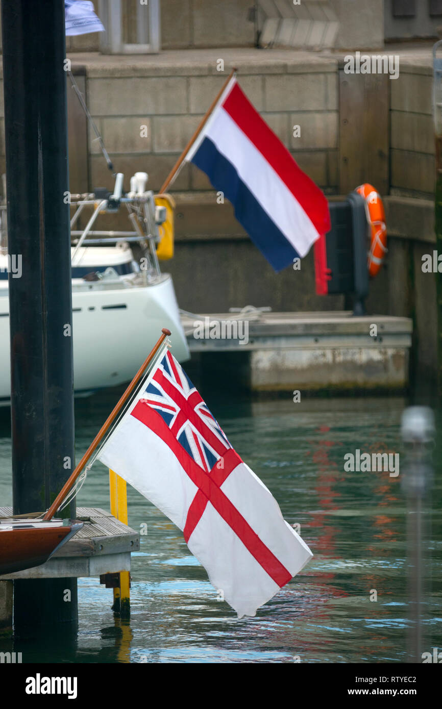 white,ensign,french,flag,on,stern,of yacht,boat,Royal Yacht Squadron, Cowes,Isle of Wight,England,UK, - Stock Image