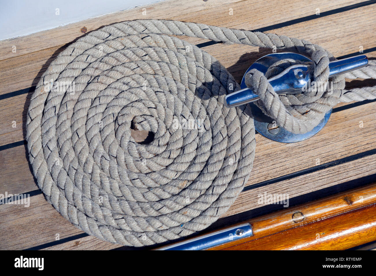 classic, boat, yacht, coiled, rope, deck, sheet, cleat, - Stock Image