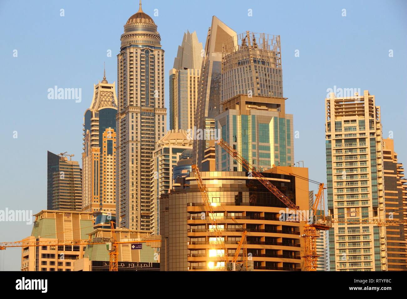 DUBAI, UAE - NOVEMBER 23, 2017: Sunset light skyline of Dubai Marina district, United Arab Emirates. Dubai is the most populous city in UAE and a majo - Stock Image