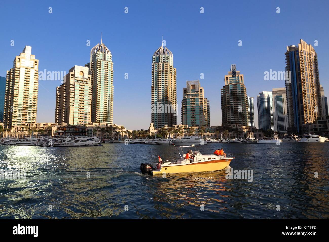 DUBAI, UAE - NOVEMBER 23, 2017: Boating in Dubai Marina district, United Arab Emirates. Dubai is the most populous city in UAE and a major global city - Stock Image
