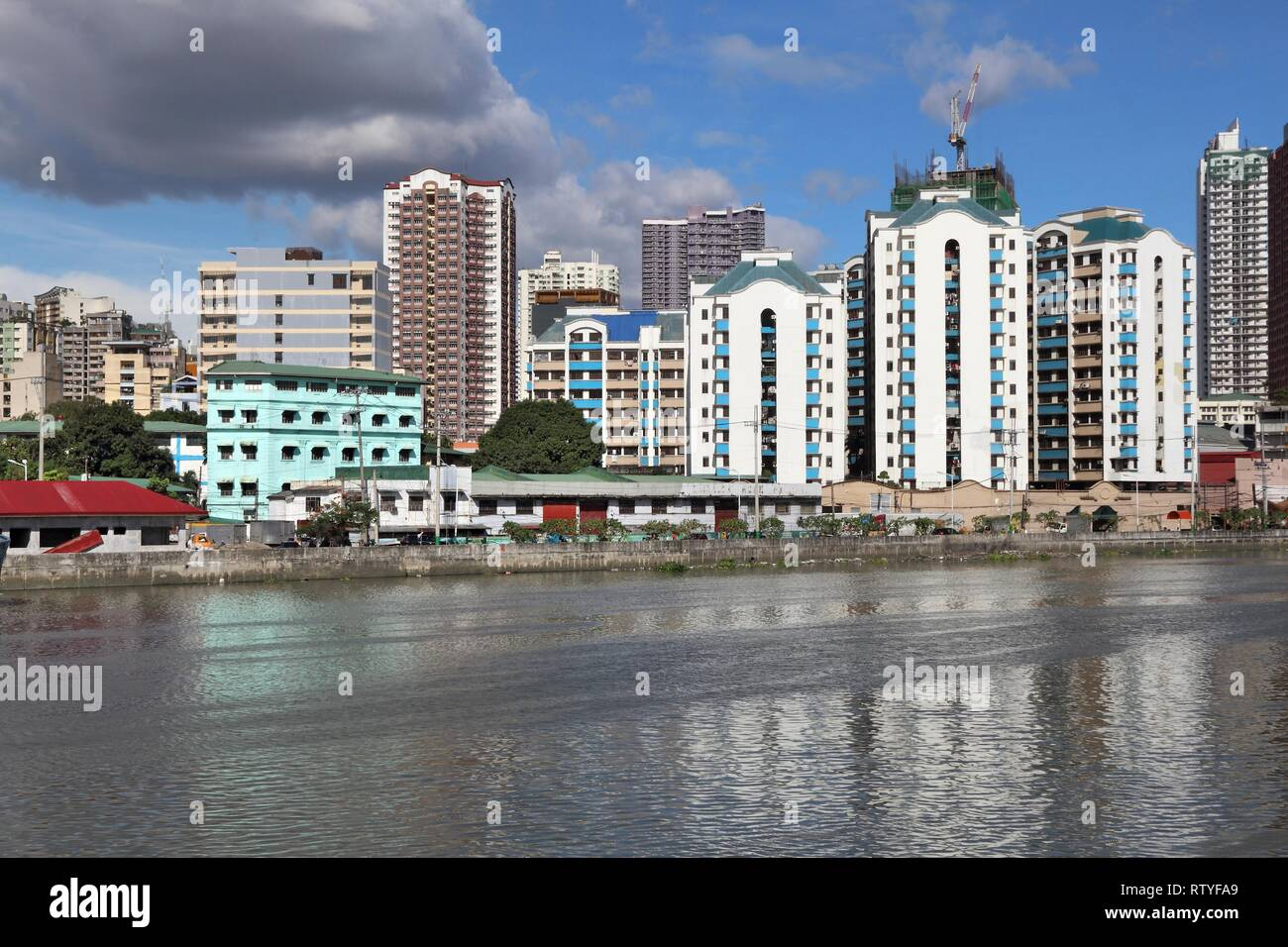 Manila city skyline in Philippines. Residential towers and Pasig River. - Stock Image