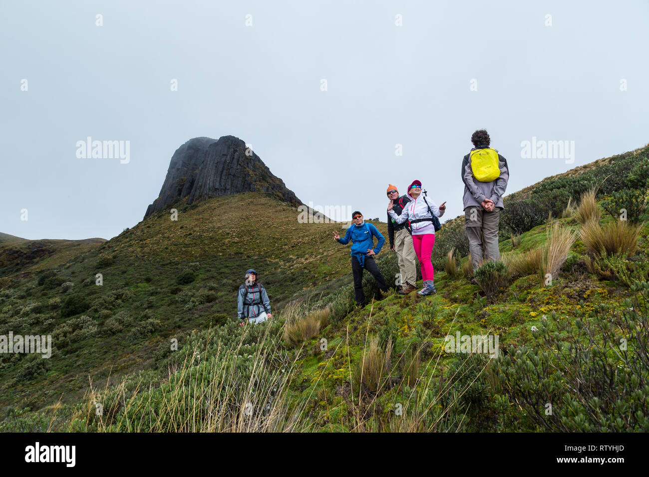 Papallacta, Ecuador, July 2018: A group of mountaineers take a break before continuing to climb the Cerro del Conde in the background, in one of the f - Stock Image