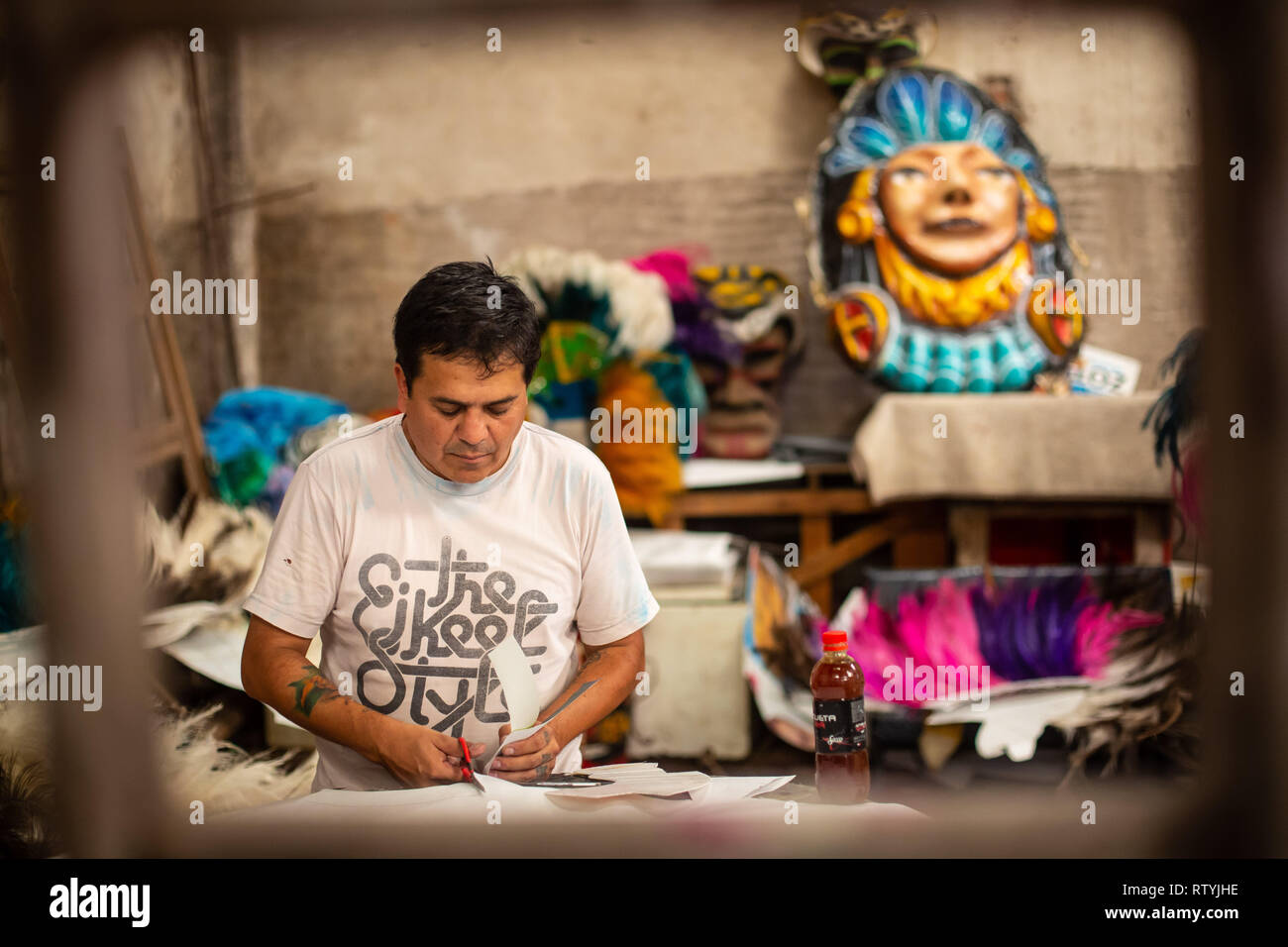 Salta, Argentina. 02nd Mar, 2019. Ariel Olivera, 44 years old, works in the workshop of the group 'Los Inca' and makes hats. For more than 35 years the group has been represented in the traditional carnival parades throughout the country. Credit: Javier Corbalan/dpa/Alamy Live News - Stock Image