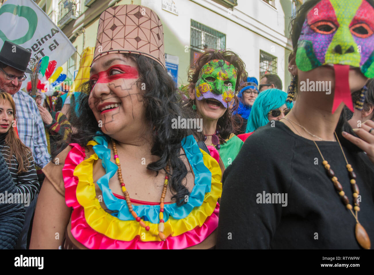 Madrid, Spain. 03rd Mar, 2019. Multicultural carnival on the streets of the neighbourhood of Lavapiés. In the picture a group of musicians with mask of pachamama Credit: Alberto Sibaja Ramírez/Alamy Live News Stock Photo