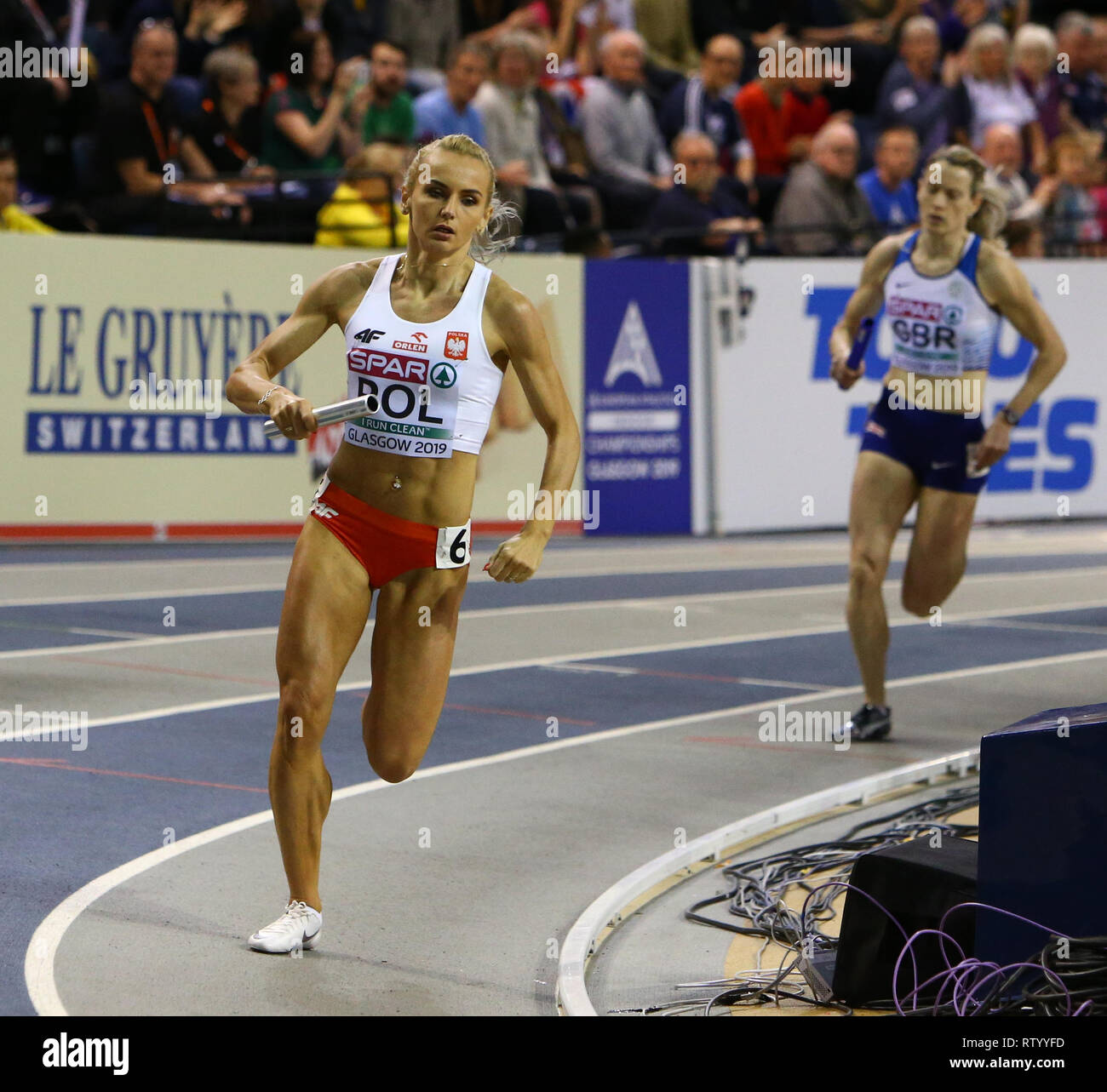 Emirates Arena, Glasgow, UK. 3rd Mar, 2019. European Athletics Indoor Championships, day 3; Justyna Swiety-Ersetic (POL) opens up a gap in front of Eilidh Doyle (GBR) during the womens 4x400m relay Credit: Action Plus Sports/Alamy Live News - Stock Image