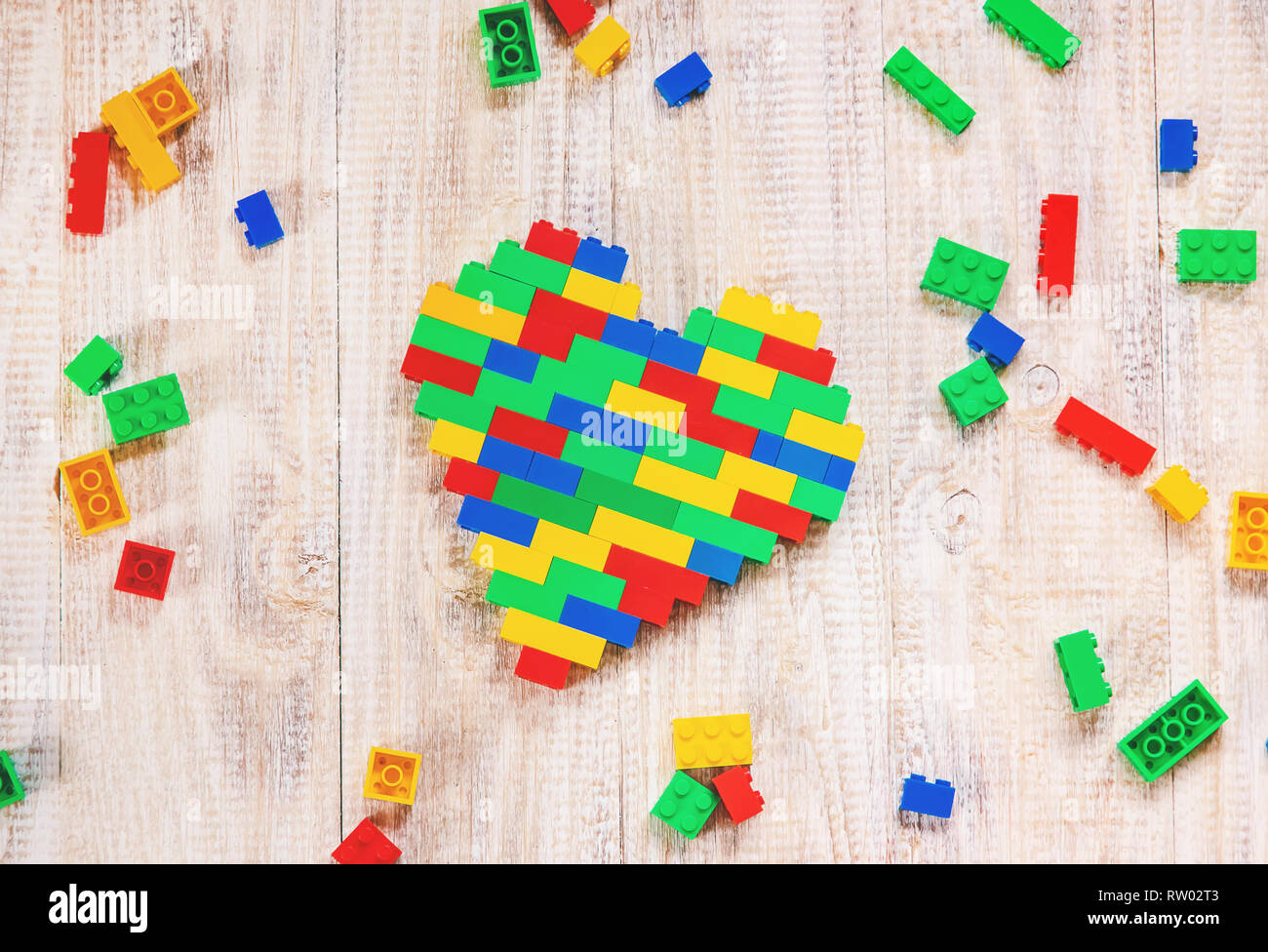 Build a designer Lego heart  Selective background  Play Stock Photo