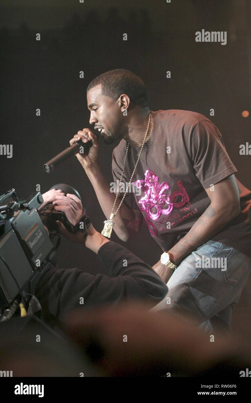Rapper, record producer and singer Kanye West is shown performing on stage during a 'live' concert appearance. - Stock Image
