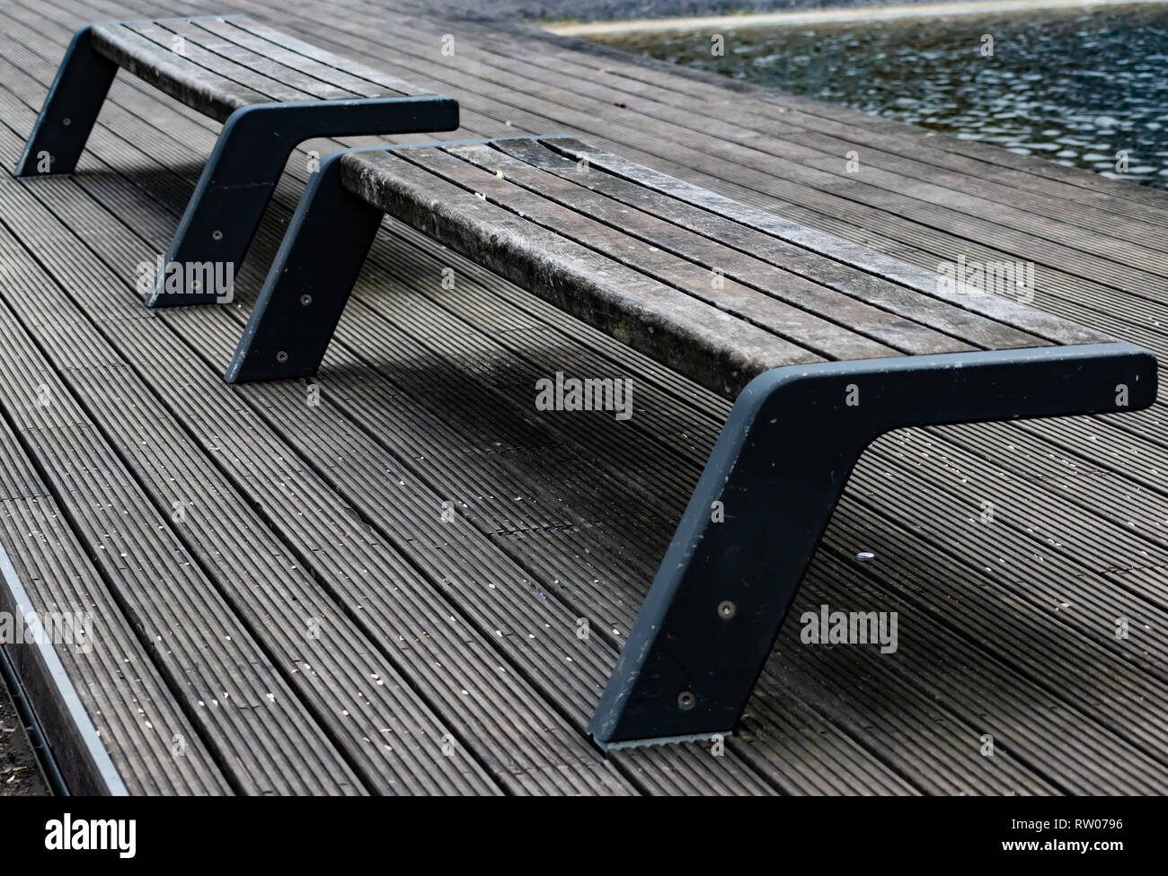 Park benches overlooking stream in Essen, Germany - Stock Image