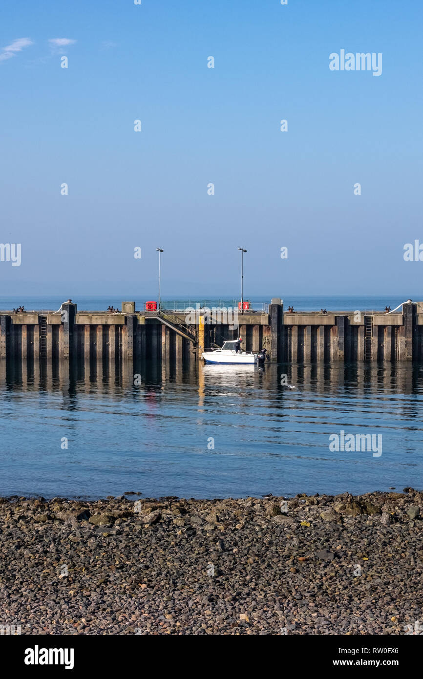 Largs, Scotland, UK - February 27, 2019: Unusually warm February weather for Largs Pier on the West coast of Scotland with bright blue sky and tempera - Stock Image
