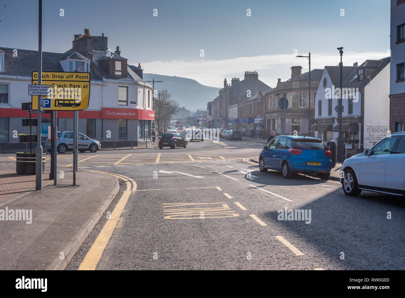 Largs, Scotland, UK - February 27, 2019: Unusually warm February weather looking up Main Street Largs on the West coast of Scotland with bright warm h - Stock Image