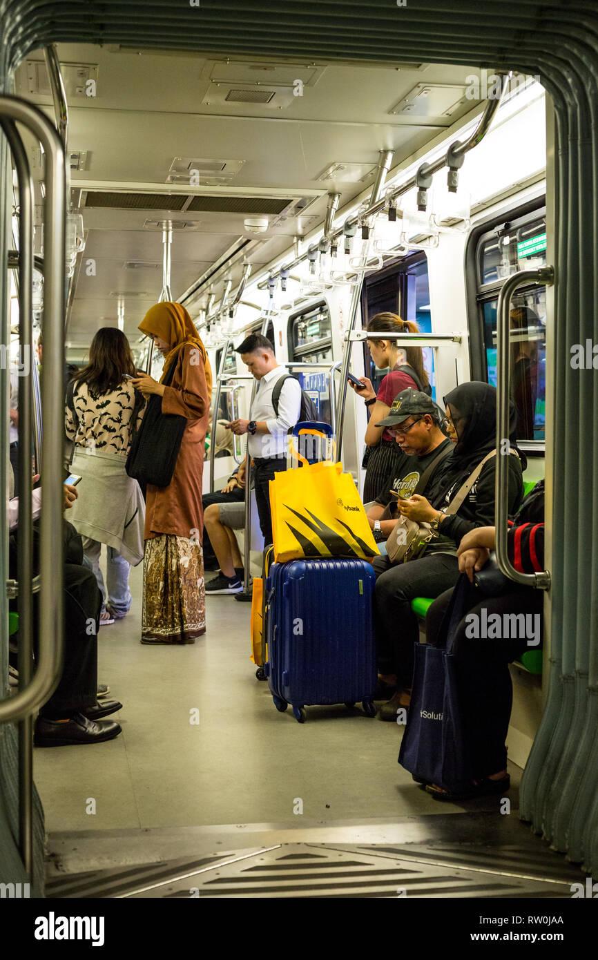 Passengers on the MRT (Mass Rapid Transit), Kuala Lumpur, Malaysia. Stock Photo