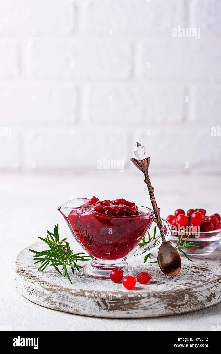 Cranberry sauce with rosemary and fresh berry - Stock Image