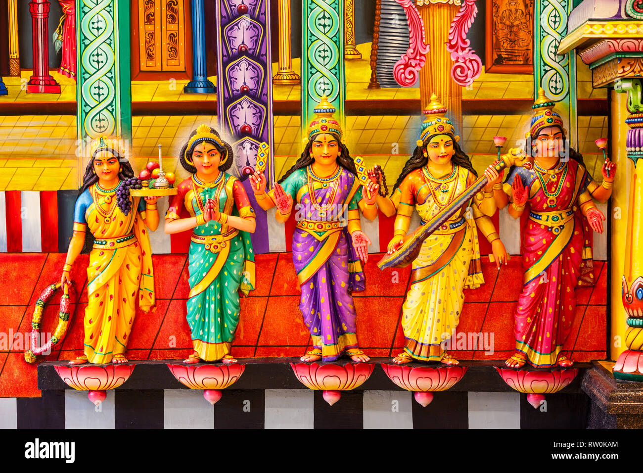 Batu Caves, Hindu Deities Line Wall of Temple at Base of Steps leading to Caves, Selangor, Malaysia. - Stock Image