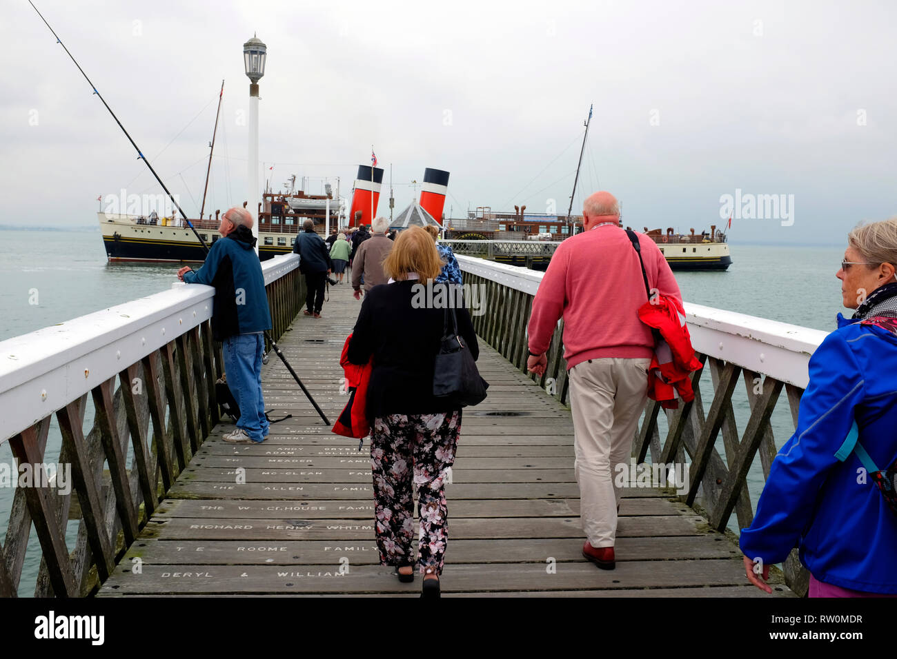 Passengers, alighting, on, fishing, anglers, PS, Waverley, Paddle Steamer, Yarmouth, Pier, Isle of Wight, England,UK, - Stock Image