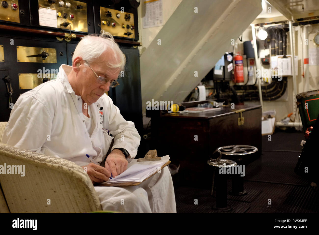 Engineer, in engine room, on , Paddle Steamer, Waverley, trip, round, the , Isle of Wight, England, UK, Stock Photo