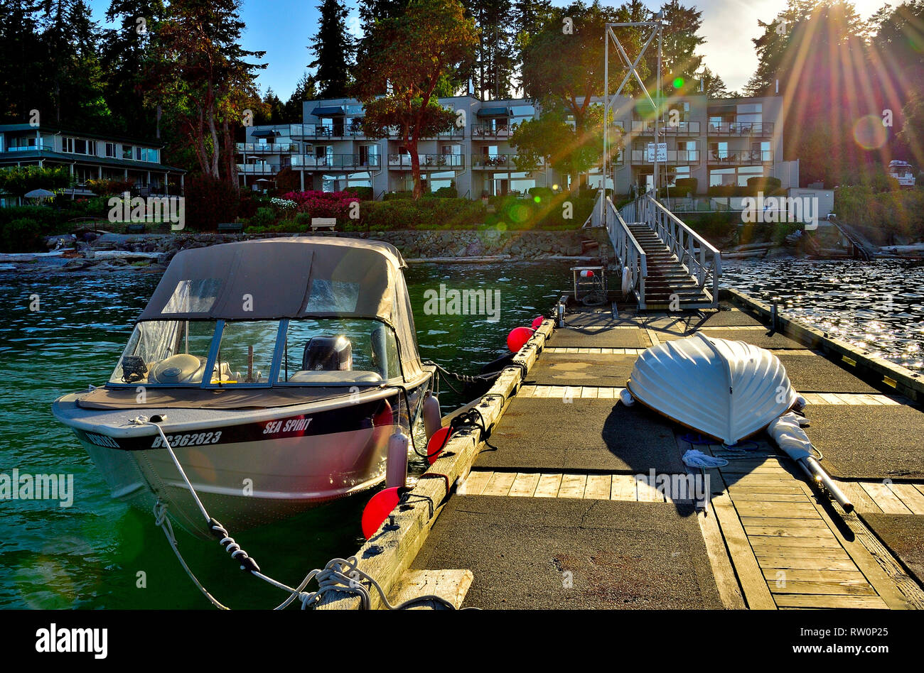 A view looking from the boat dock in toward the buildings at Inn of the Sea resort near Nanaimo on Vancouver Island British Columbia Canada. - Stock Image