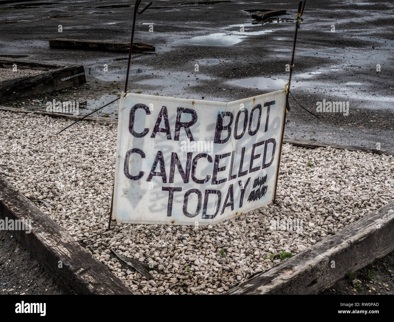Car boot cancelled Today sign on derelict  carpark - Stock Image