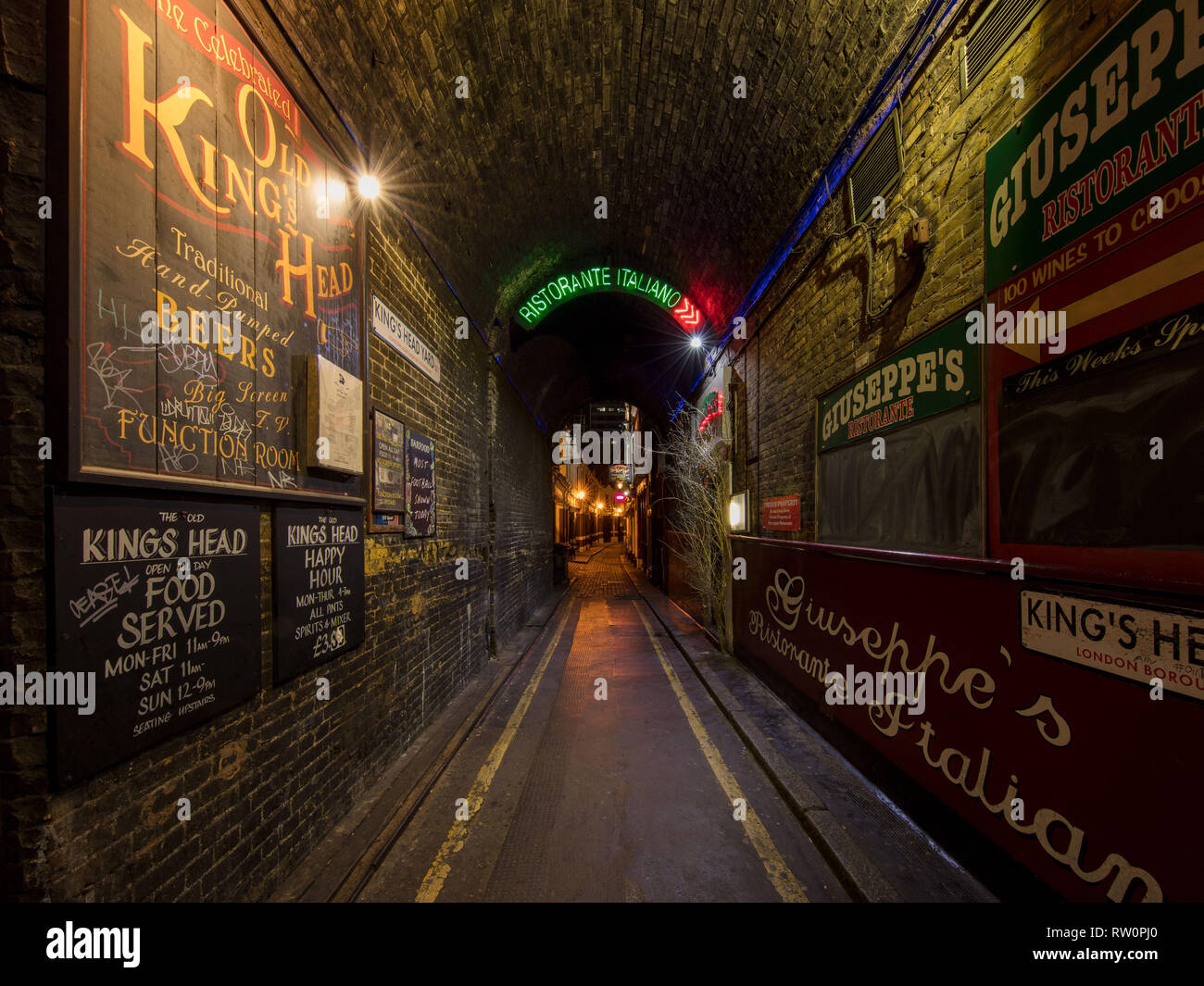 A shot of an King's Head Yard with numerous signs in London. giuseppe's Ristorante,and Old King's Head. - Stock Image