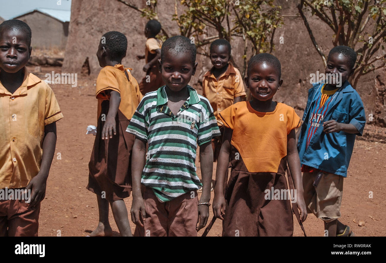 An authentic photo of beautiful happy, playful and cheerful Ghanaian school children posing outside for the camera. - Stock Image