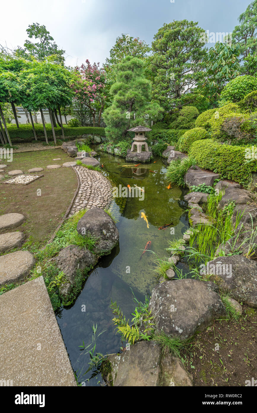 Setagaya, Tokyo, Japan - August 19, 2017: Beautiful gardens and pond of Enjo-in or Enjou-in. Shingon sect, Toyoyama school of Buddhism temple. One of  Stock Photo