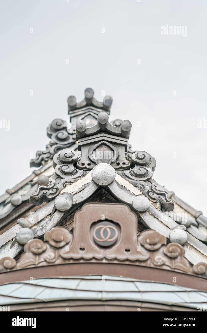 Setagaya, Tokyo, Japan - August 19, 2017: Ayasuji style shishiguchi End tile roof ornament of Enjo-in or Enjou-in. Shingon sect, Toyoyama school of Bu Stock Photo
