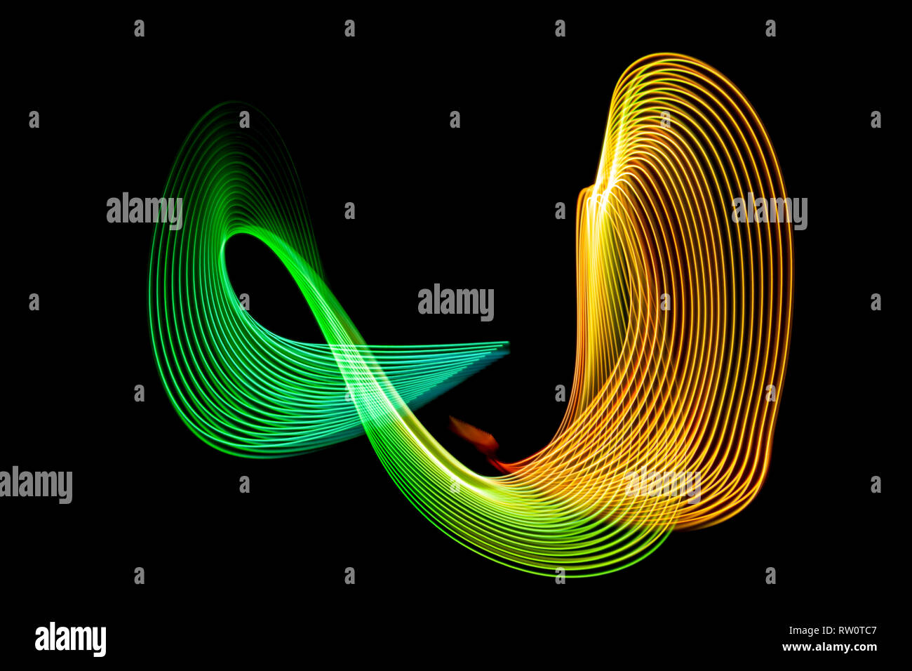Colorful blue, yellow, green and orange neon spiral lines.Abstract background of blue neon glowing light shapes. Bright stripes for poster, website, - Stock Image