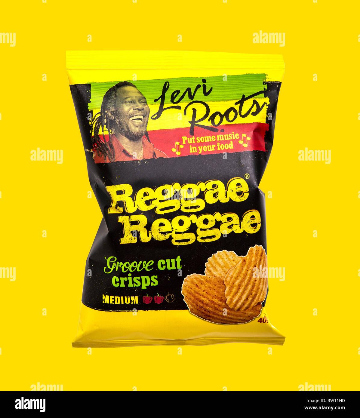 SWINDON, UK - MARCH 3, 2019: Levi Roots Reggae Reggae Groove cut crisps on a yellow background - Stock Image