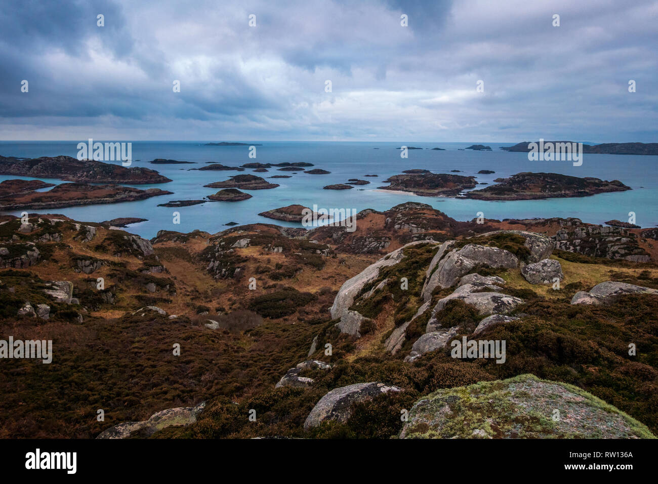 View of the archepelago in the blue hour of the morning from the summit of the Isle of Erraid in the Inner Hebridean islands of Scotland - Stock Image