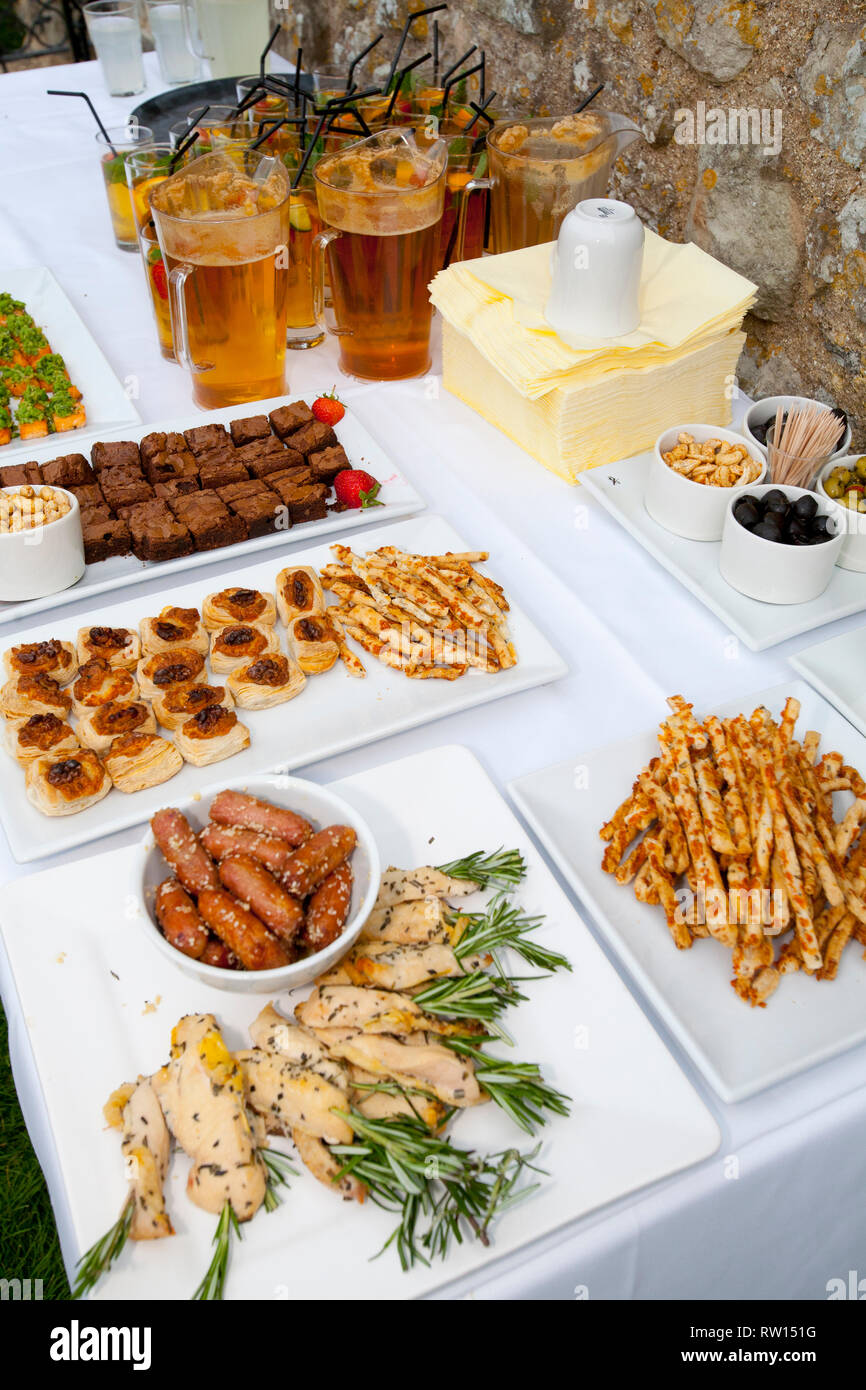 Pims, Buffet, Canpaes, Cocktail Sausages, Chicken Pieces, Olives, Dips, Tourism Cocktail Party, Garden, English Heritage, Carisbrook Castle, England, - Stock Image