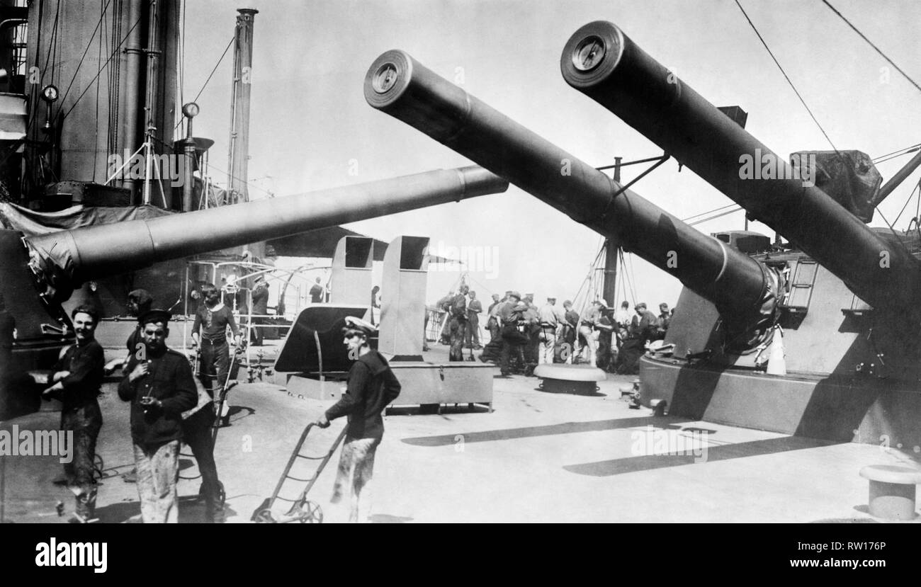 12 inch guns amidships aboard HMS Indomitable an invincible class battlecruiser dreadnought cruiser of the royal navy circa 1907  Image updated using digital restoration and retouching techniques - Stock Image