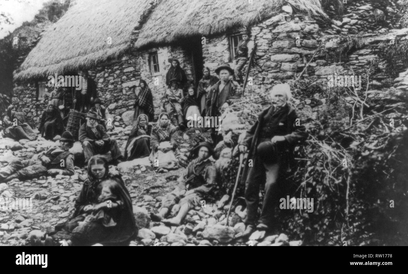 Irish peasant farmers in the west of Ireland circa 1900  Image updated using digital restoration and retouching techniques - Stock Image