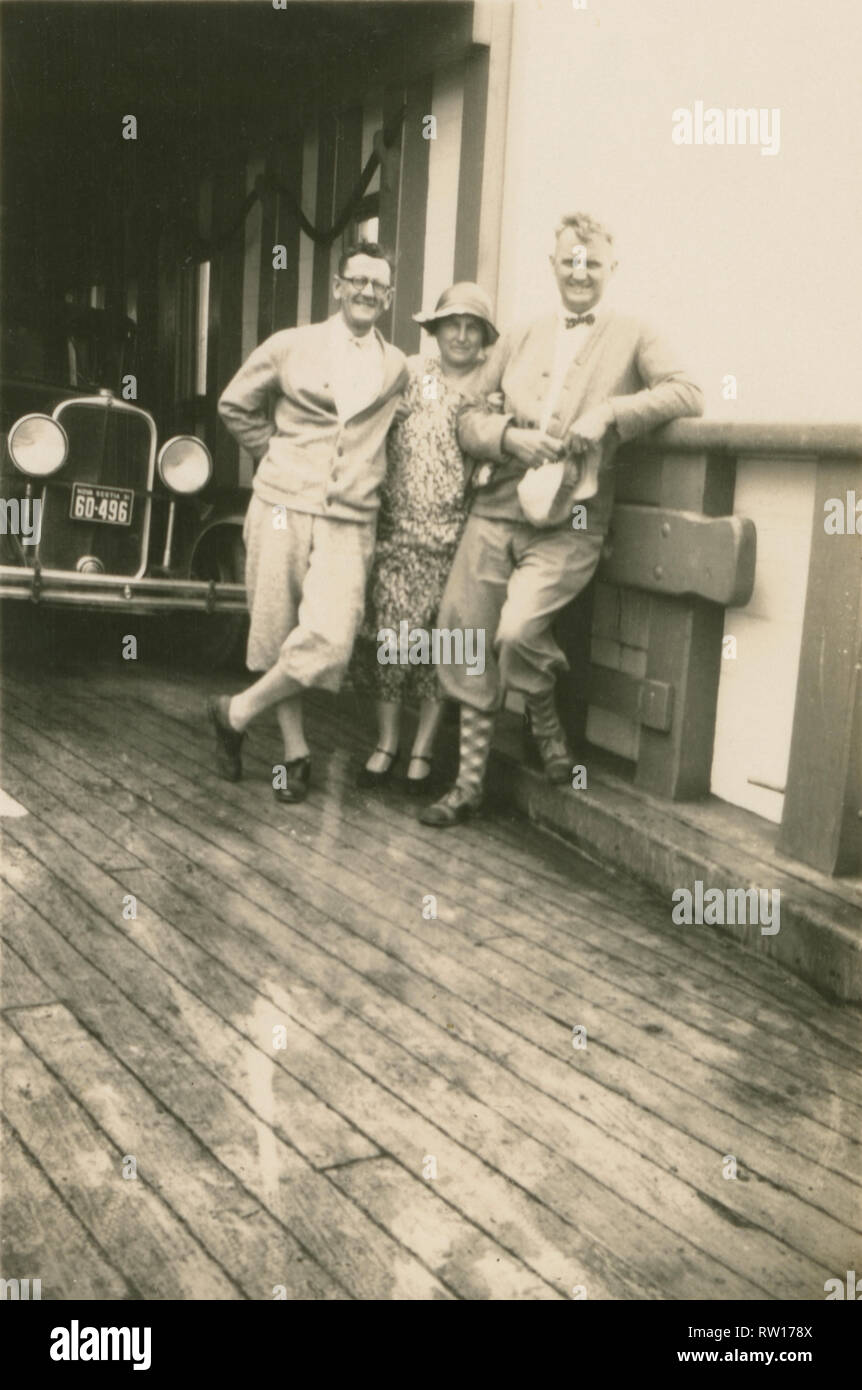Antique c1931 photograph, three people with vehicle aboard the ferry across the Strait of Canso, Nova Scotia, Canada. SOURCE: ORIGINAL PHOTOGRAPH - Stock Image