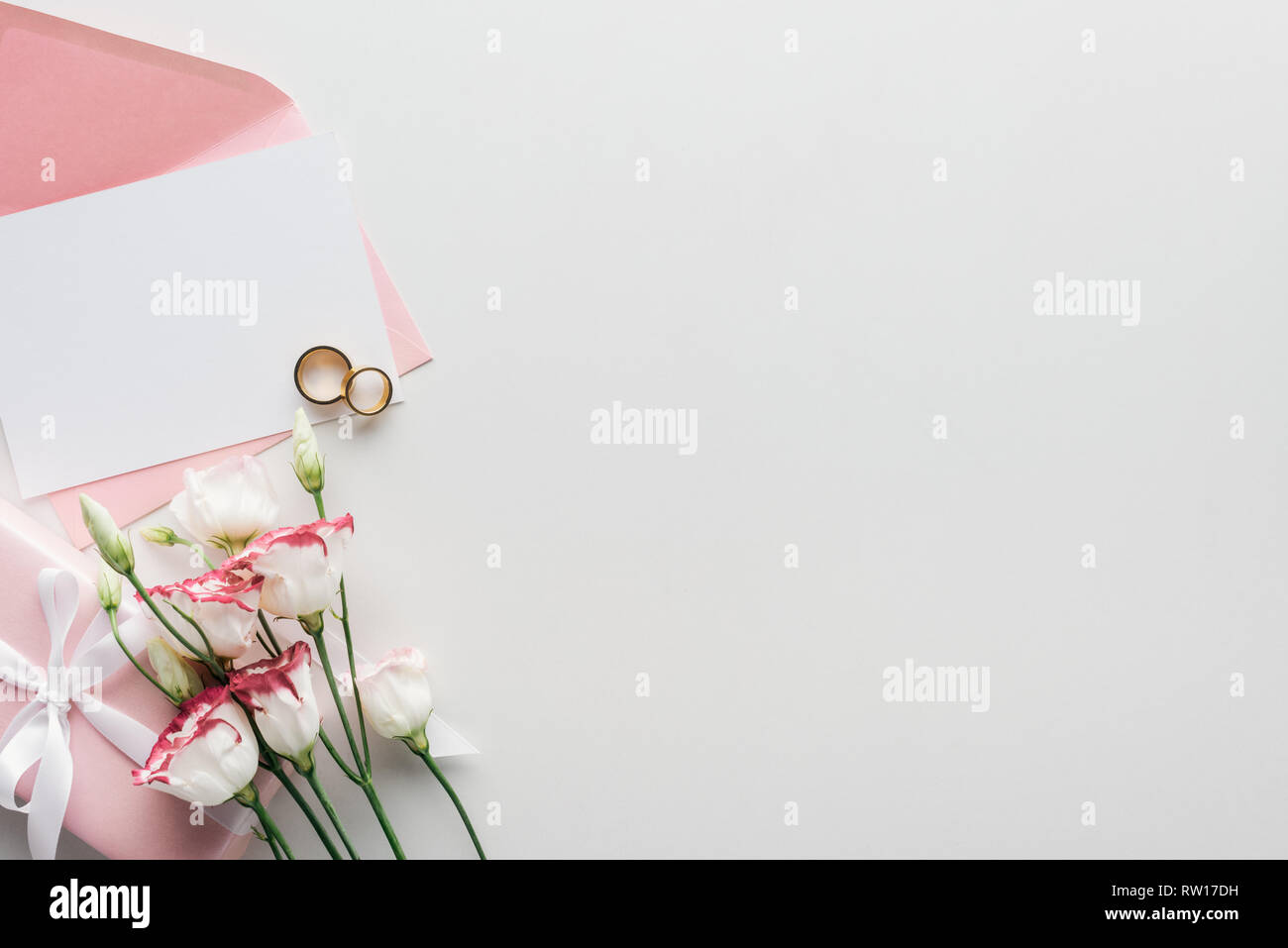 Top View Of Empty Card With Pink Envelope Flowers Wrapped