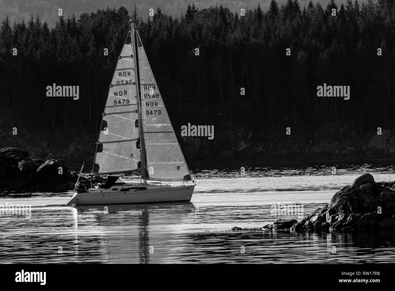 Sail boat Alida sailing between islets in Raunefjord, westcoast Norway - Stock Image