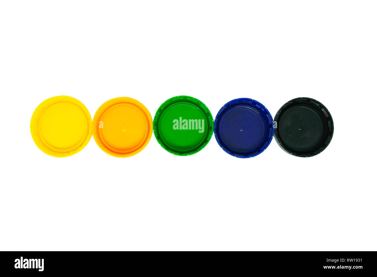 Five plastic caps isolated on white background - Stock Image