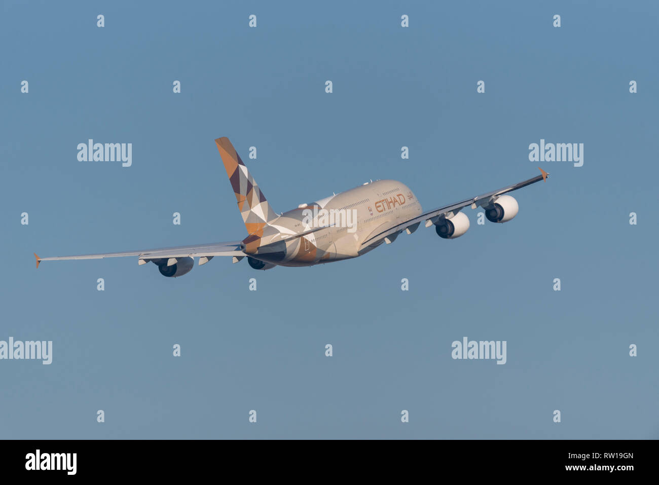 Etihad Airways Airbus A380 superjumbo jet airliner plane A6-APC taking off from London Heathrow Airport, UK, in blue sky. Space for copy - Stock Image