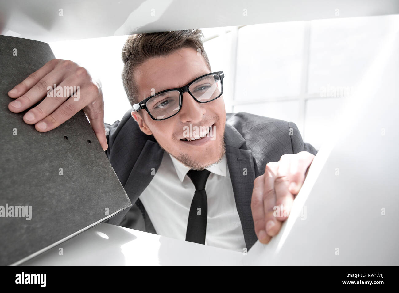 man looks at the folder with documents - Stock Image