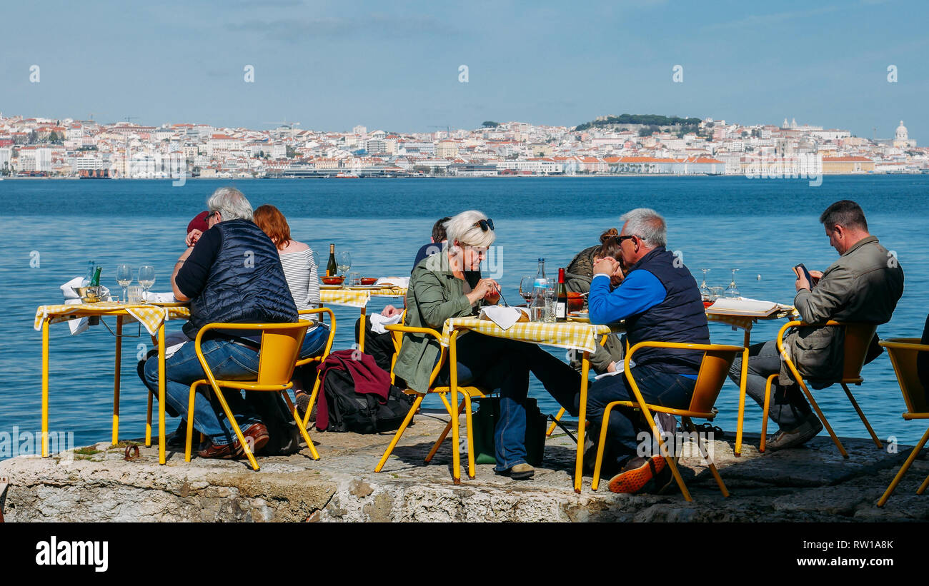 Lisbon Portugal March 2nd 2019 People Sitting At Yellow