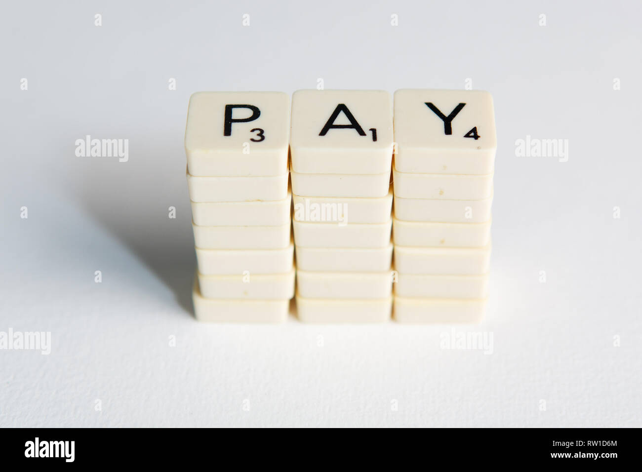 Tiles spell out the word 'pay' symbolizing a pay rise Stock Photo