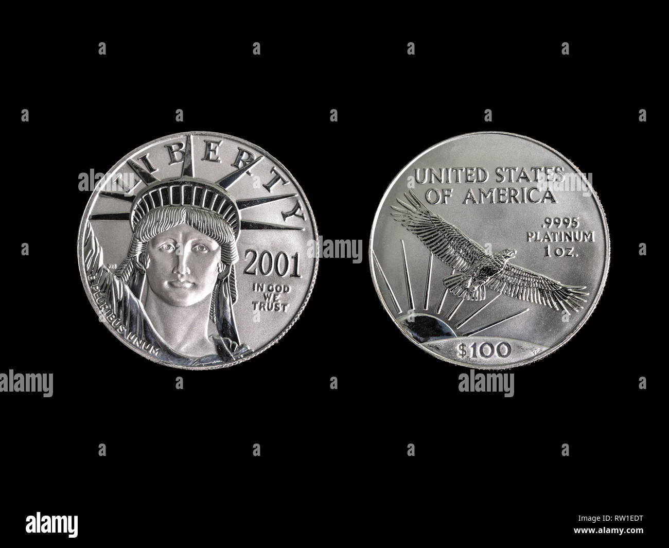 100 dollar 1oz Platinum coin macro close up photograph on a black background. - Stock Image