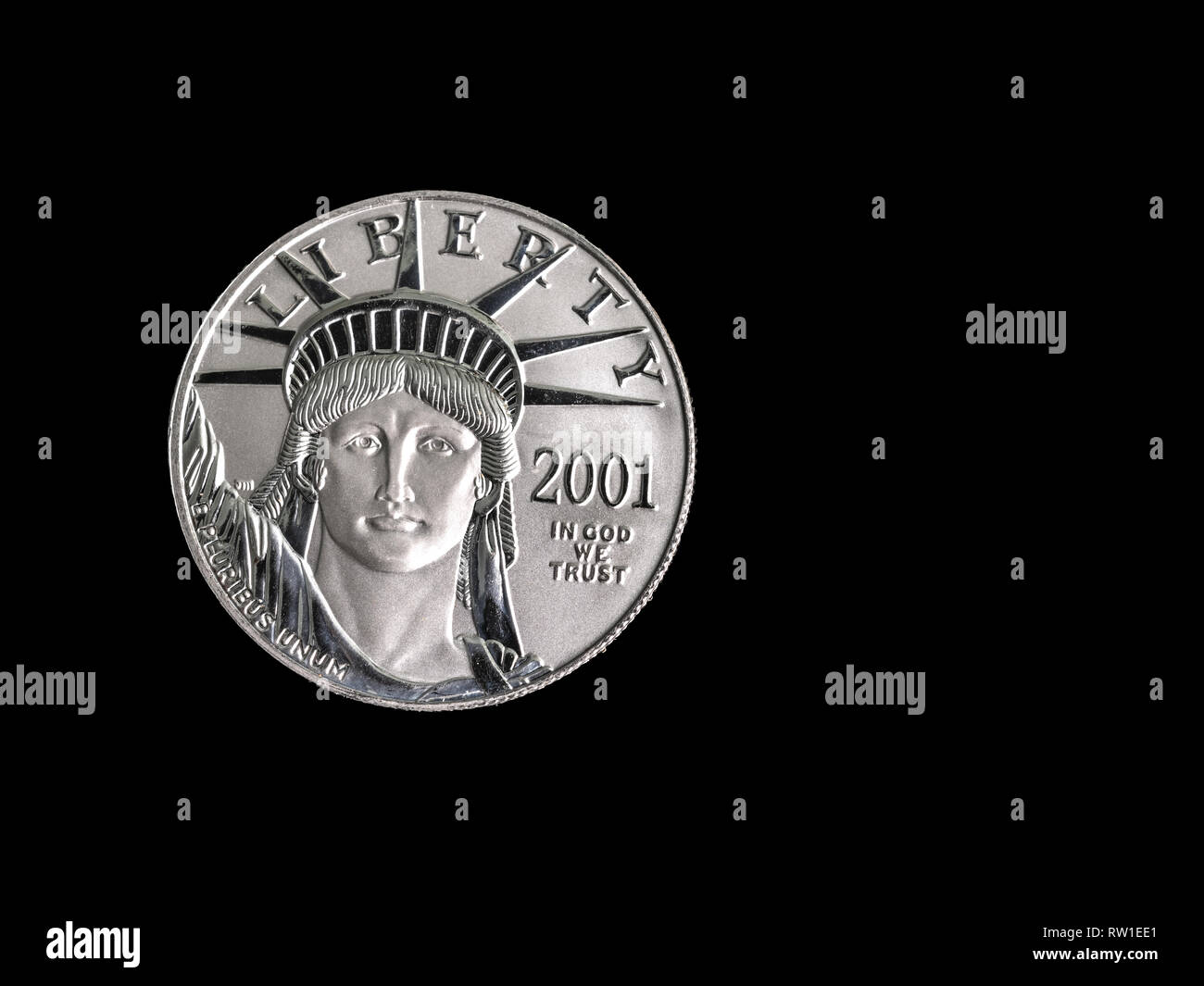 100 Dollar 1oz USA Platinum coin macro close up photograph on a black background with copy space. - Stock Image