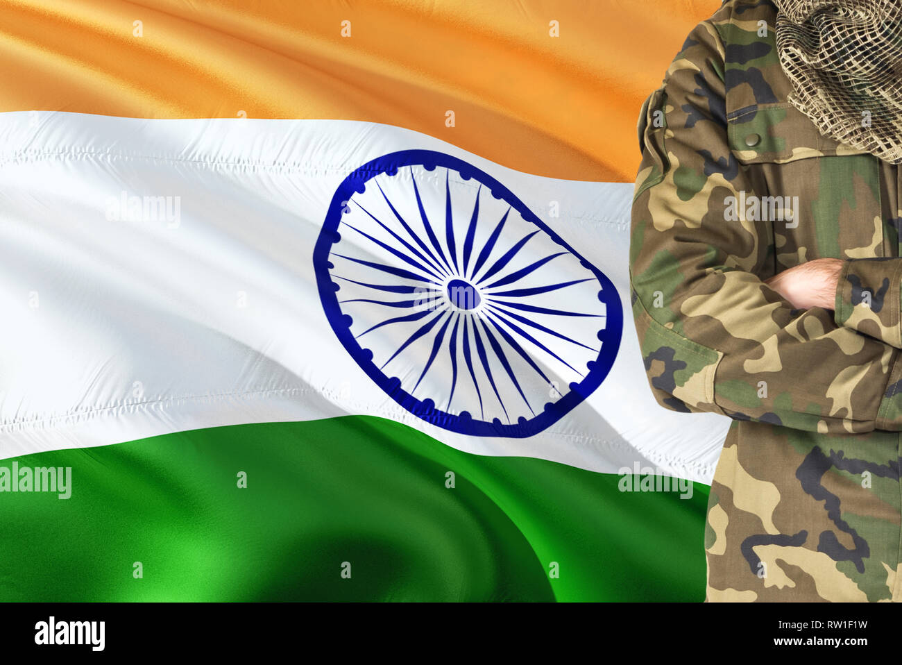Crossed Arms Indian Soldier With National Waving Flag On Background India Military Theme Stock Photo Alamy