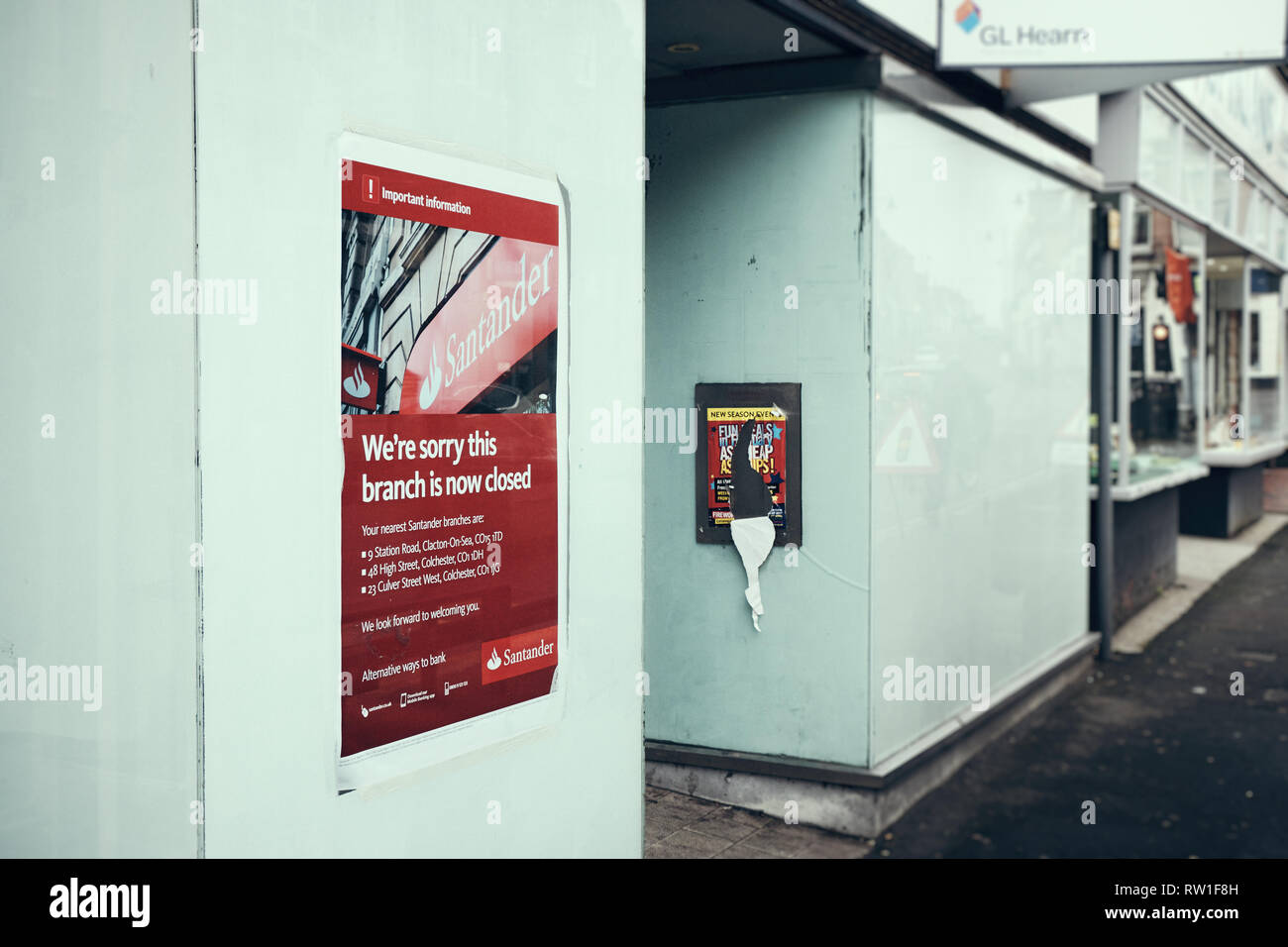 Harwich & Dovercourt, Essex, ENGLAND - March 3, 2019: A wide side view of a poster informing of the branch closure of Santander in Harwich High Street - Stock Image