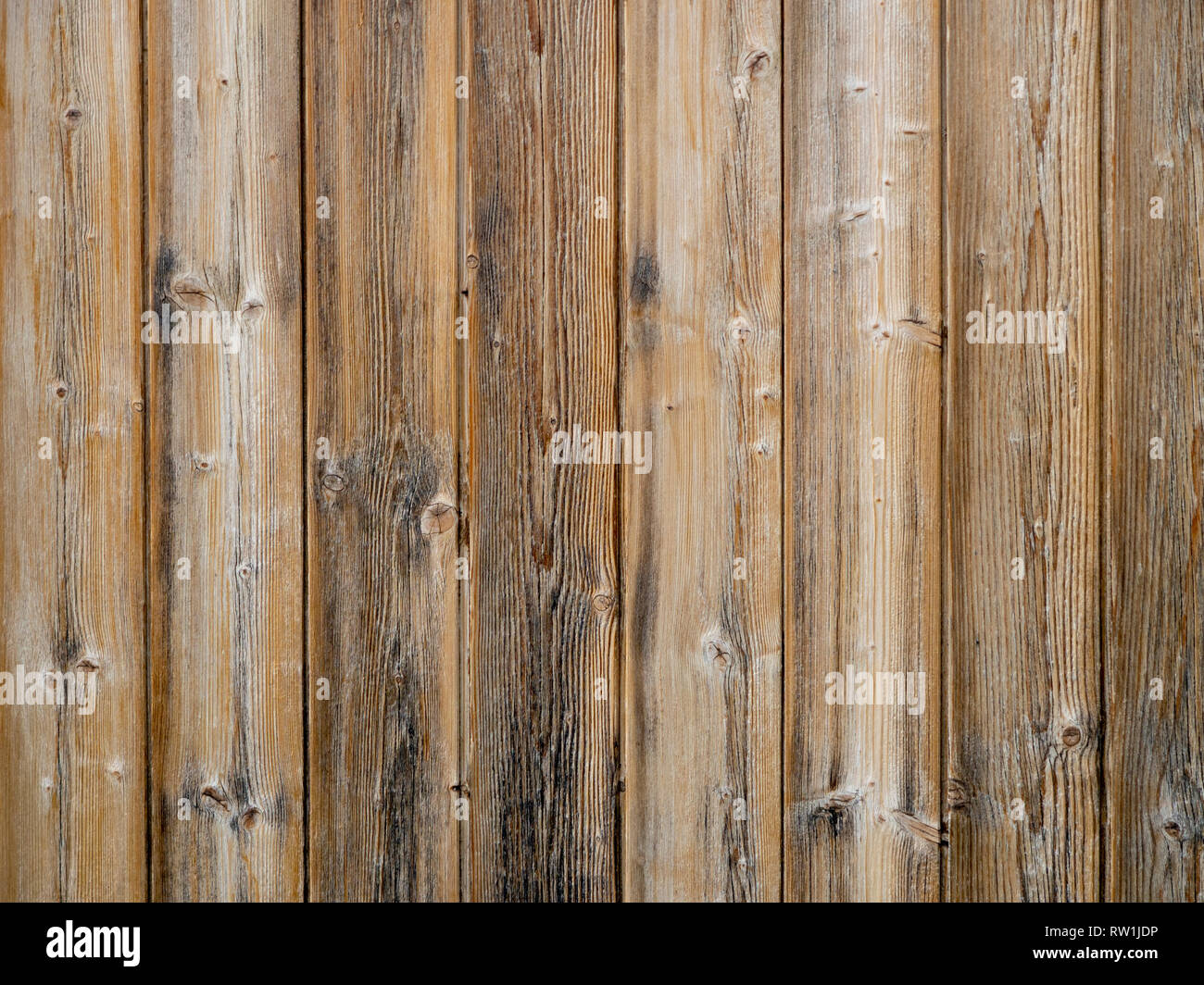 Wood slats background,old exterior cladding with vertical planks. - Stock Image